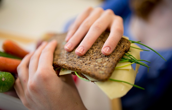 Student with a healthy breakfast, lunchbox filled with wholewheat bread, fruit and vegetables on September 19, 2014, in Goettingen, Germany. The Georg-Christoph-Lichtenberg-Gesamtschule is a comprehensive school. Photo by Michael Gottschalk/Photothek via Getty Images)***Local Caption***